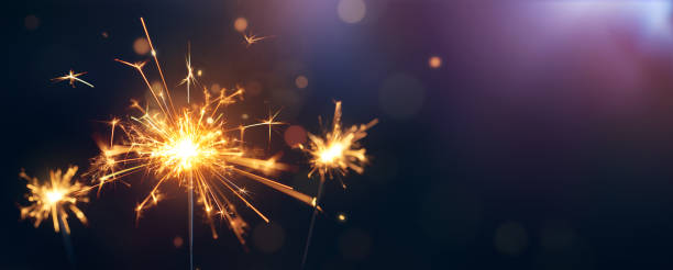 Burning sparkler, Happy New Year stock photo