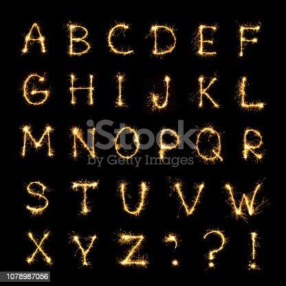 istock Burning sparkler letters isolated on black background 1078987056