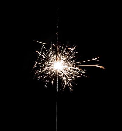 istock Burning sparkler on black background. 880561816