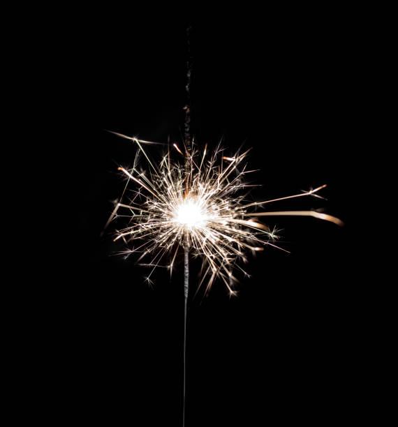 burning sparkler on black background. - sparkler stock pictures, royalty-free photos & images