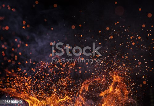 istock Burning sparks flying. Beautiful flames background. 1163495640