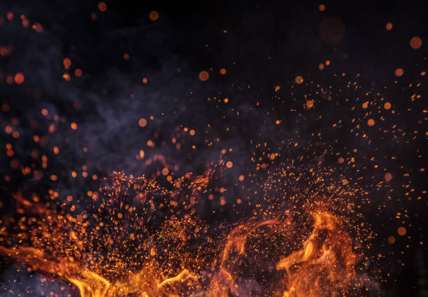Burning sparks flying. Beautiful flames background. Burning sparks flying. Beautiful flames. Fiery orange glowing flying away particles on black background. flame stock pictures, royalty-free photos & images