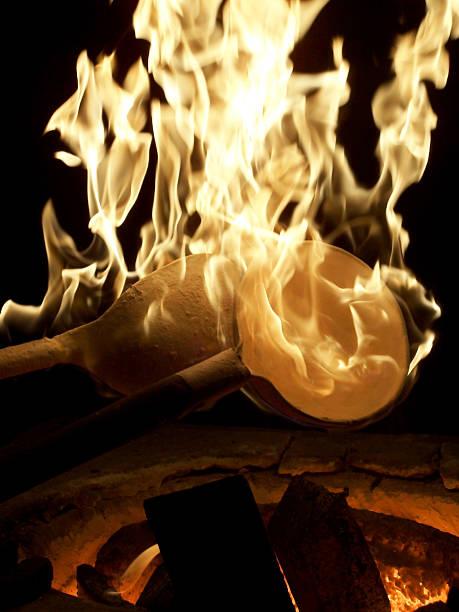 Burning spoons stock photo