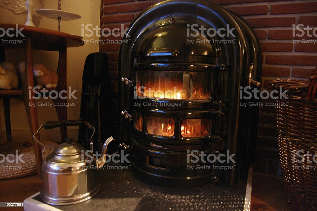 Burning stove at home royalty-free stock photo
