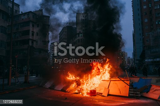 Burning street blockade in Hong Kong, China.