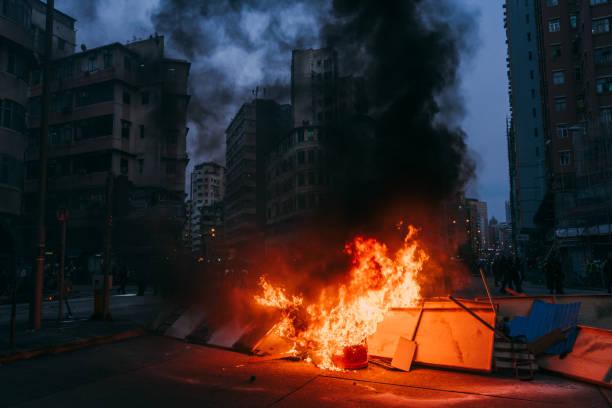 burning street blockade, protesters blocked roads stock photo