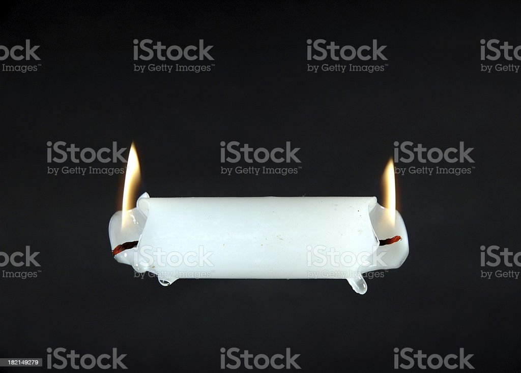 Burning the Candle at Both Ends royalty-free stock photo