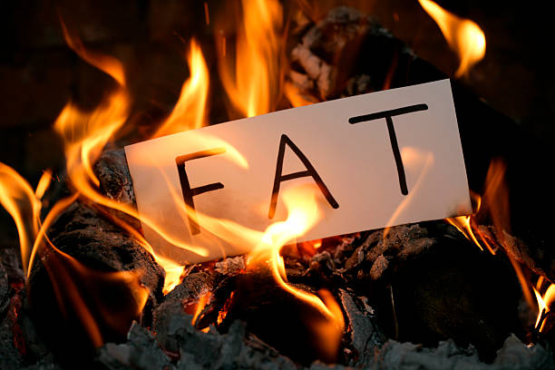 burning the fat - burning stock pictures, royalty-free photos & images