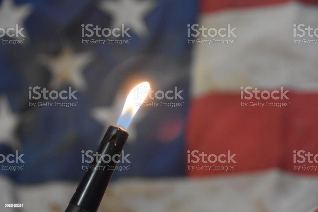 Burning the US flag stock photo