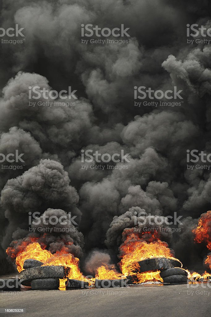 Burning tires causing toxic pollution stock photo
