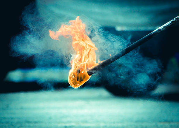 Burning Torch in the Night Burning Torch in the Night, Concept image flaming torch stock pictures, royalty-free photos & images