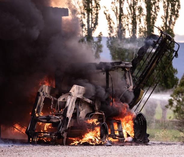 Burning tractor stock photo