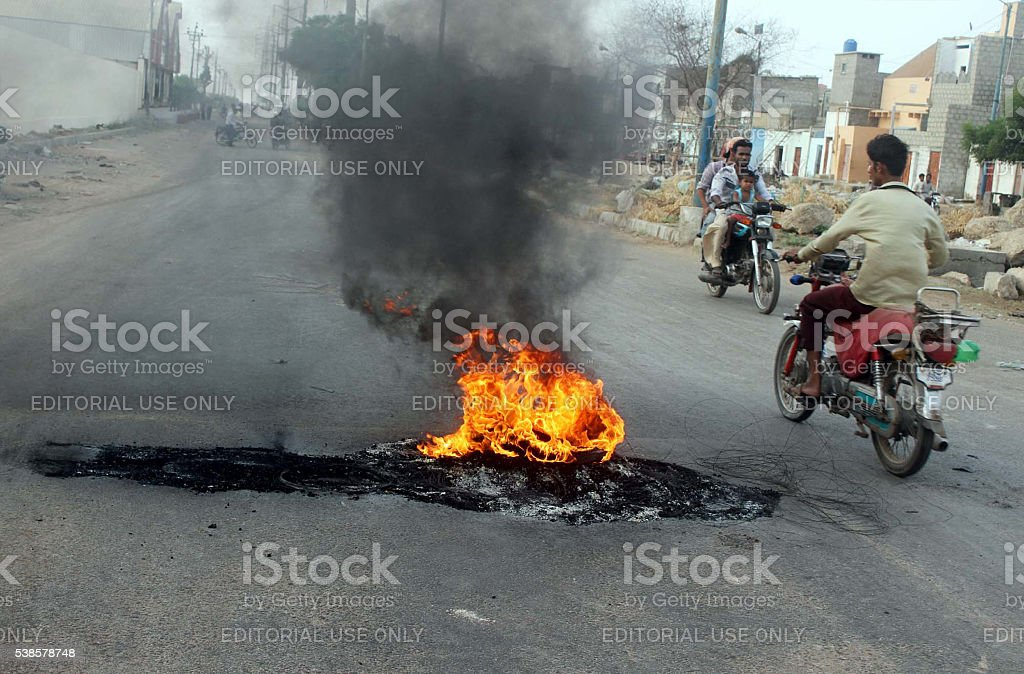 Burning tyres during strike called by MQM stock photo