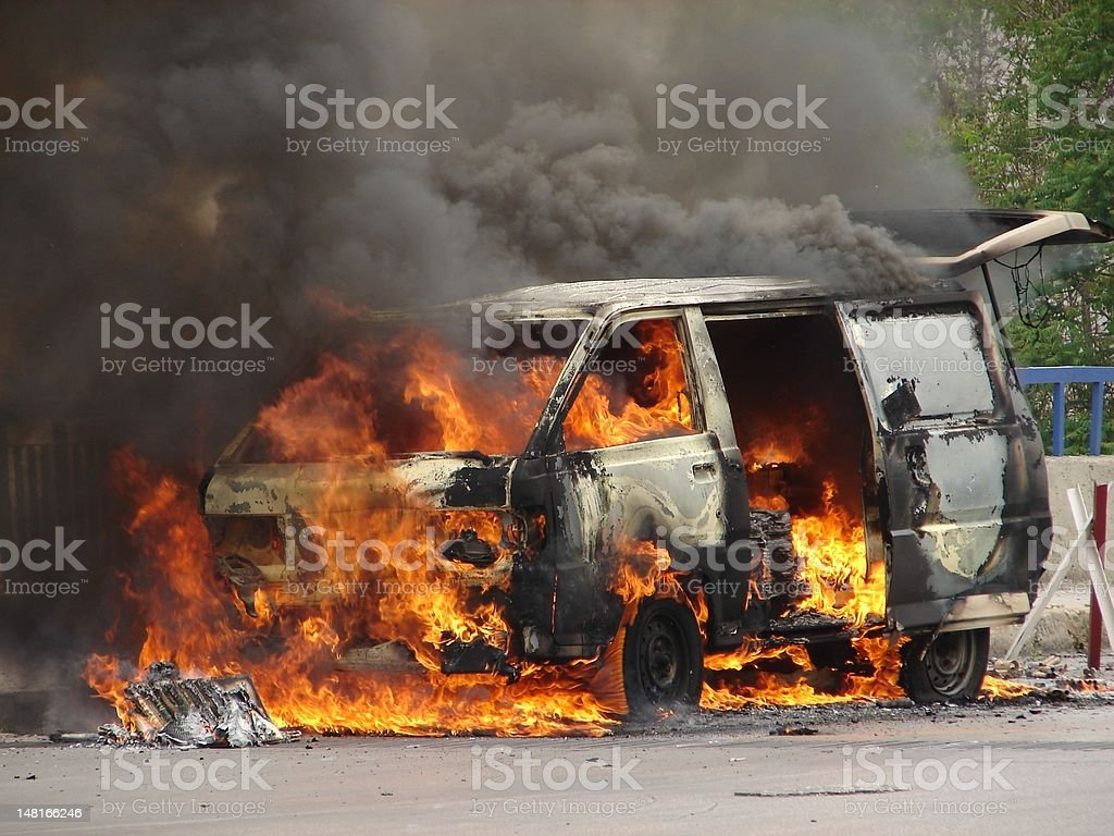 Burning Van caused by a Bomb stock photo
