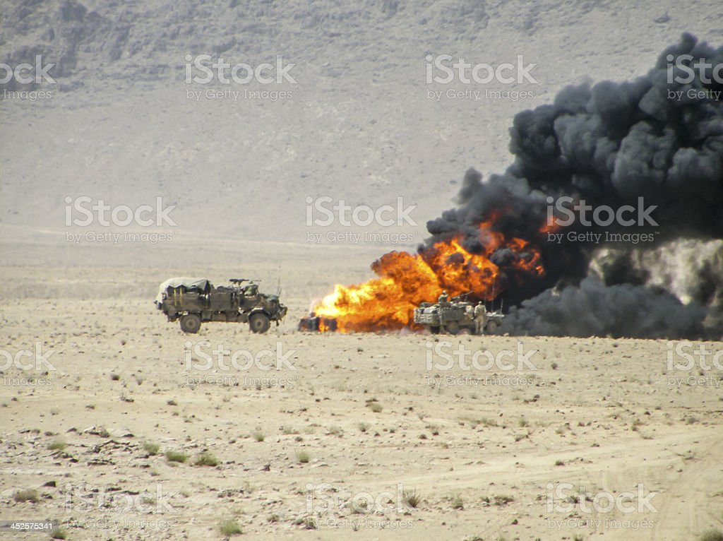 Burning vehicle in Afghanistan War stock photo