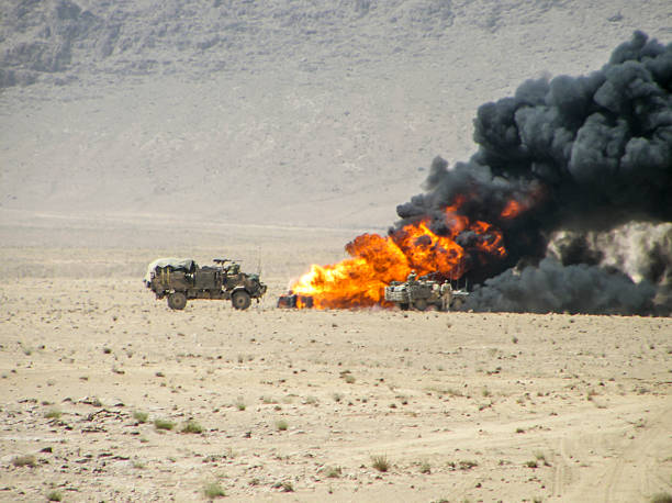 Burning vehicle in Afghanistan War Military vehicles inspecting destroyed vehicle Afghanistan stock pictures, royalty-free photos & images