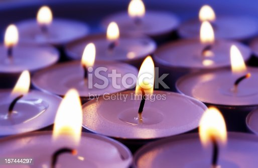 Atmospheric violett candles background