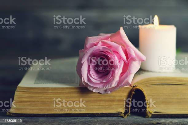 Burning white candle and pink rose on open book picture id1173005119?b=1&k=6&m=1173005119&s=612x612&h=xc0sg1arq5gb9 z9ewkcbtqwnkhm3cwiauv6lcob2co=