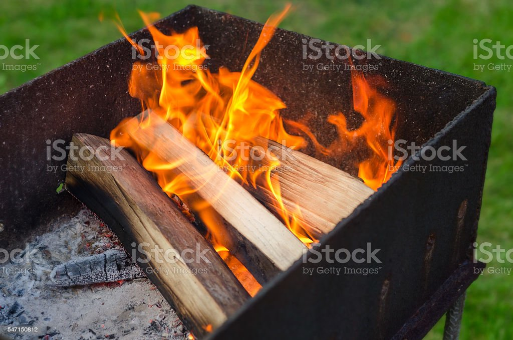 Burning wood in a brazier stock photo