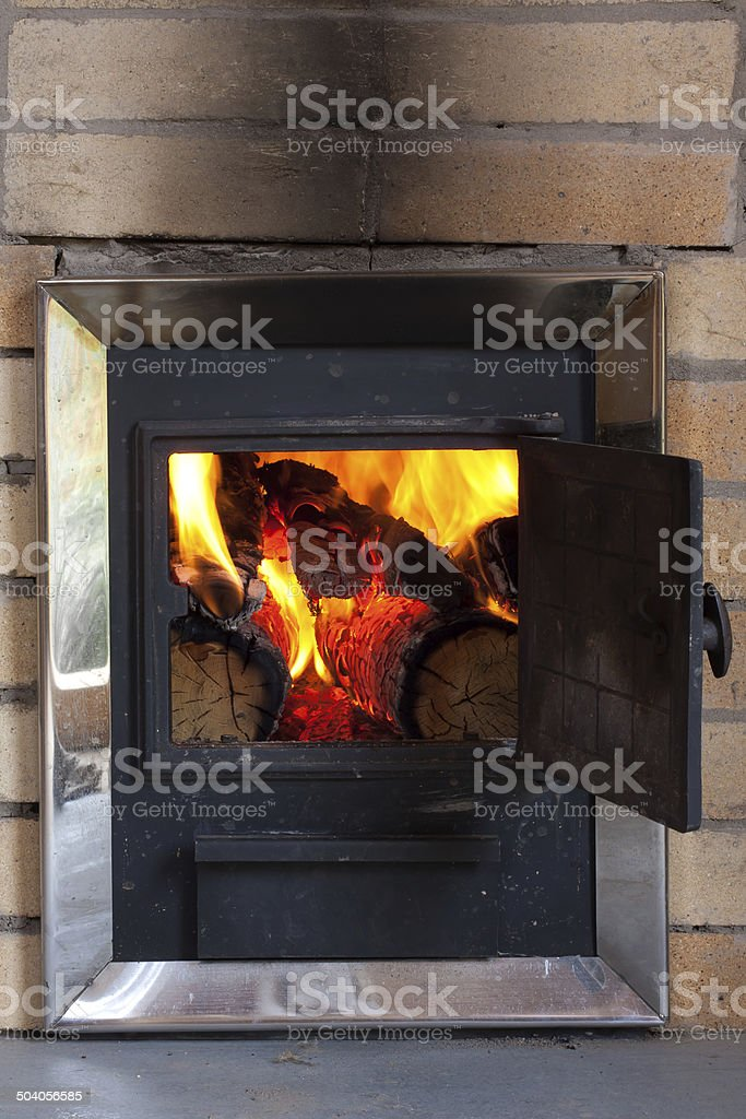 burning wood in a stove stock photo