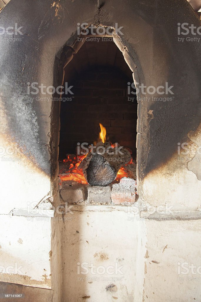 burning wood in a tandoor royalty-free stock photo