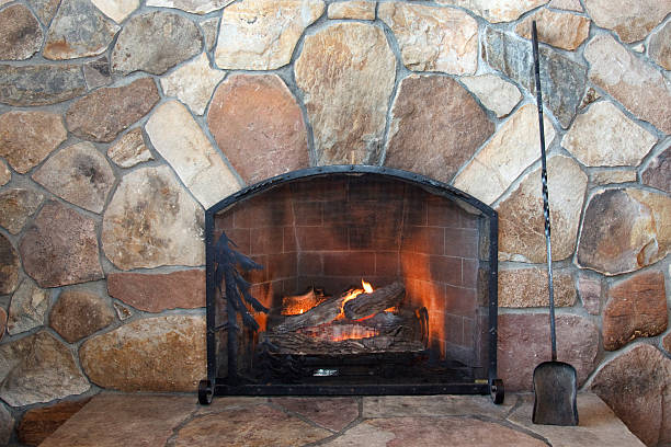 Burning wood in fireplace stock photo