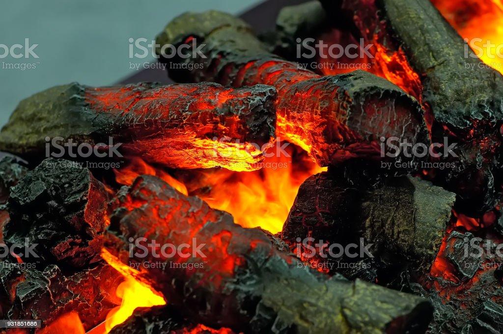 Burning wooden firewood, black hot coals stock photo