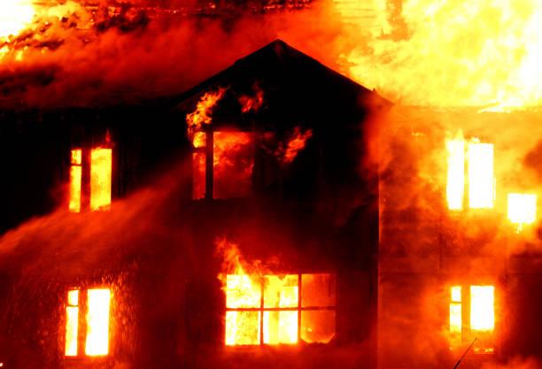 Burning wooden house stock photo