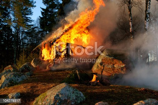istock Burning wooden house 104279317