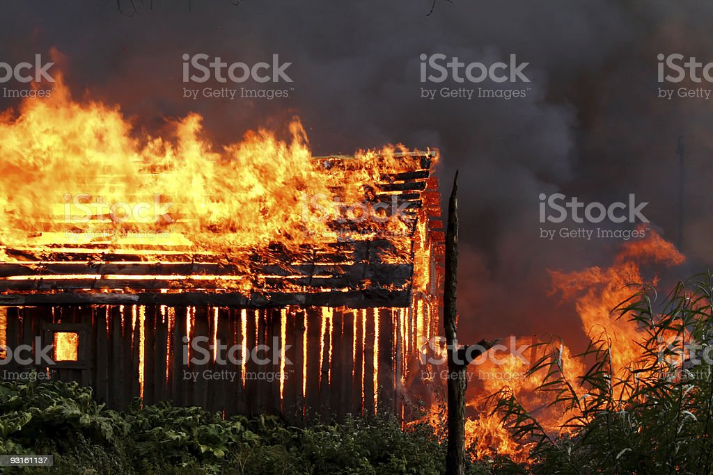 Burning wooden house royalty-free stock photo