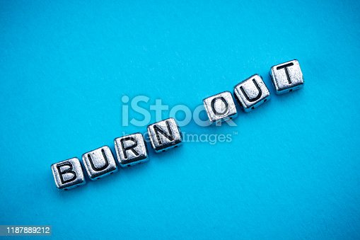1091817198 istock photo Burnout background concept with cubic metal letters 1187889212