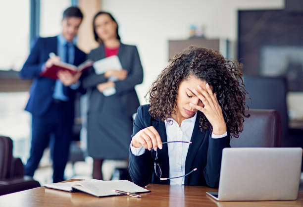 Burnout businesswoman under pressure in the office stock photo