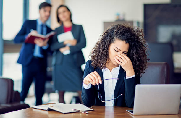 Burnout businesswoman under pressure in the office Burnout businesswoman under pressure in the office negative emotion stock pictures, royalty-free photos & images