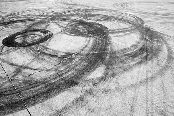 Burnout, Drifting Car, Tire Mark Tyre burnout marks on asphalt road tire track stock pictures, royalty-free photos & images