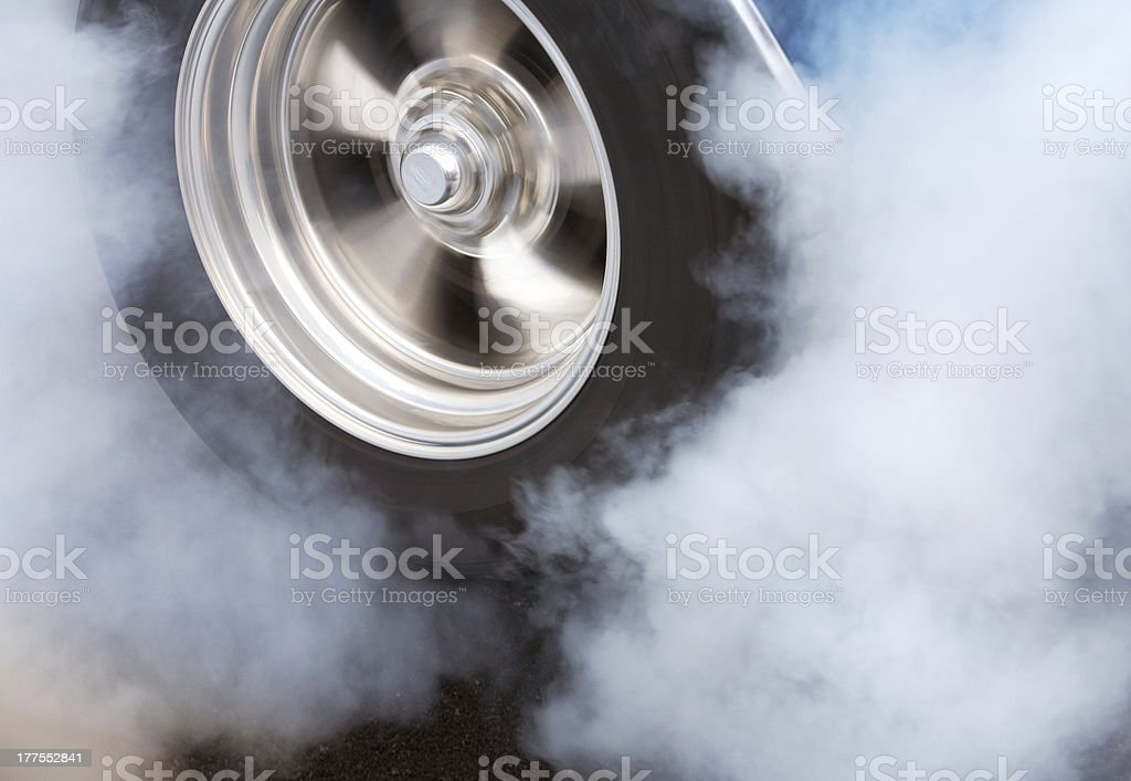 Burnout with spinning wheel stock photo
