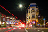 Cars pass on Burnside Road in downtown Portland Oregon USA at night.