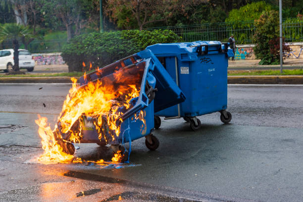 Burnt and melted trash bin from fire in the city of Athens after a demonstration event Athens, Greece - January 20, 2019: Burnt and melted trash bin from fire in the city of Athens after a demonstration event. dumpster fire stock pictures, royalty-free photos & images