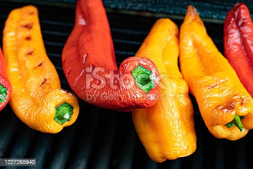 Cooked red and yellow peppers on a barbeque