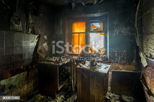 istock Burnt apartment house interior. Burned furniture and charred walls in black soot 900925360