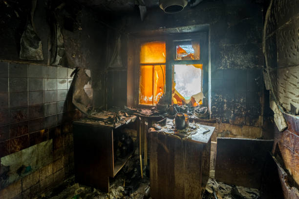 Burnt apartment house interior. Burned furniture and charred walls in black soot stock photo