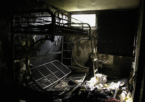 Burnt bedroom is trashed stock photo