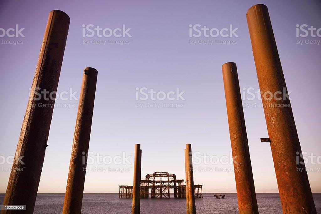 Burnt Brighton West Pier at sunrise stock photo