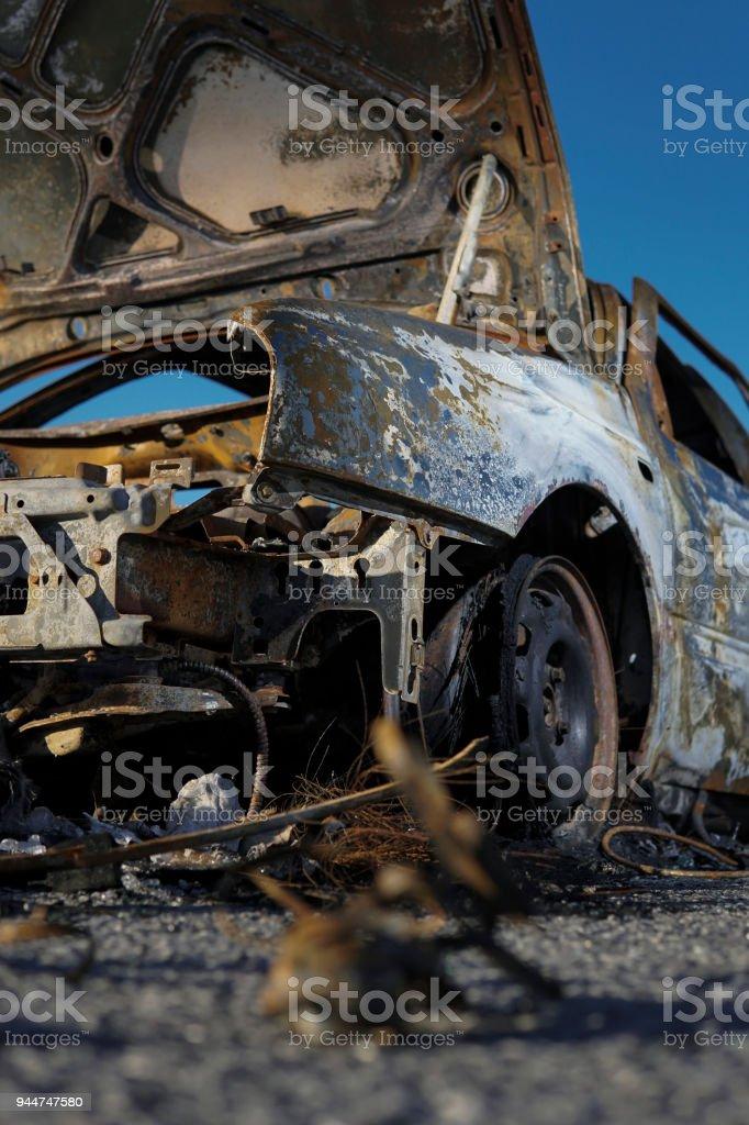 Burnt car. Vandalism.