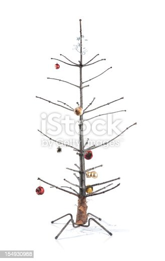 Burnt Christmas tree with decorations,, isolated on white