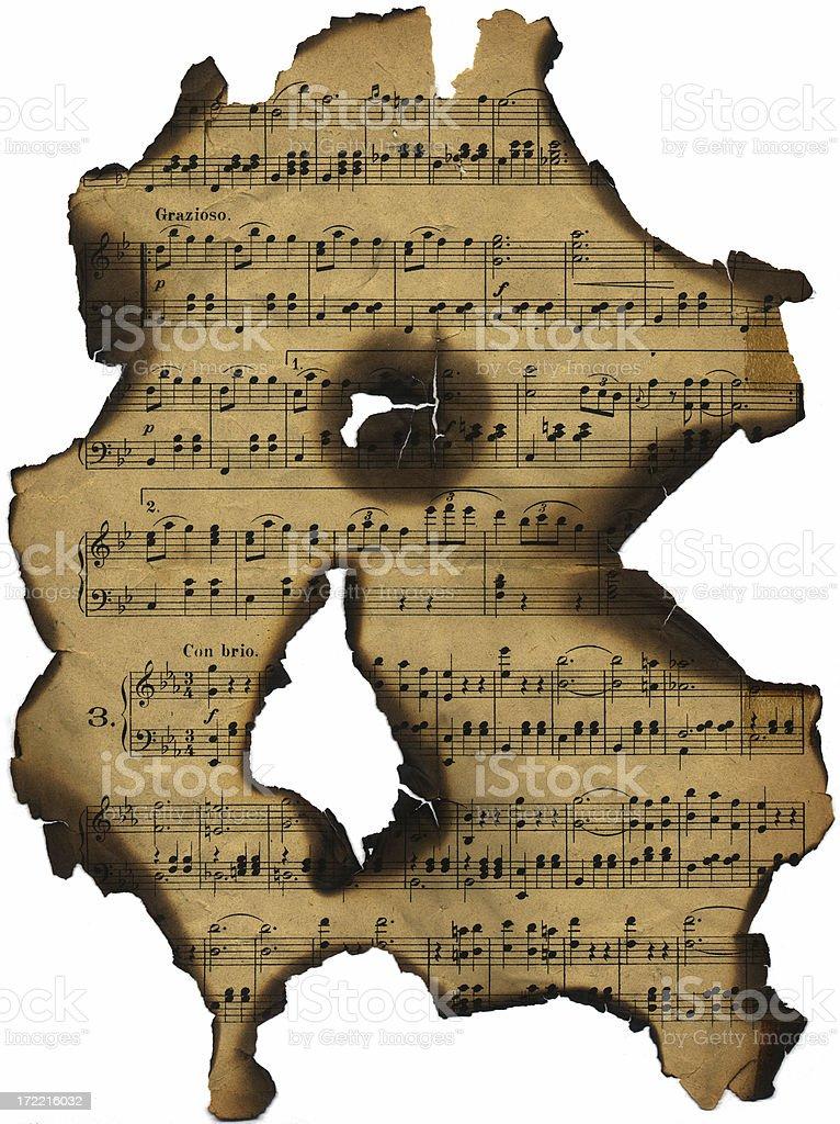 Burnt damaged old music sheet royalty-free stock photo