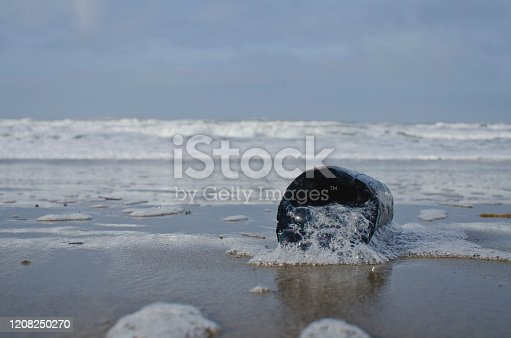 470521655 istock photo A burnt drift wood on the cold beach 1208250270