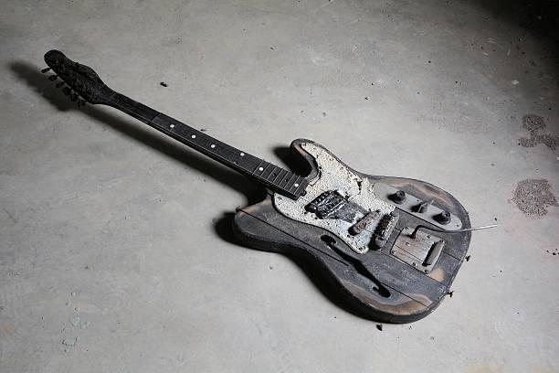 burnt guitar - broken guitar stock photos and pictures