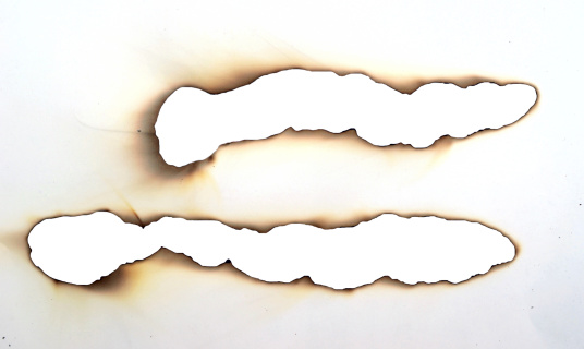 long burnt holes in a paper