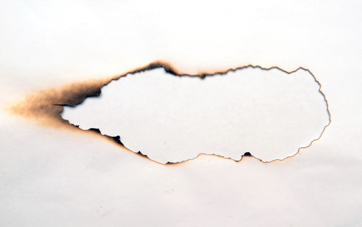 burnt hole in a paper