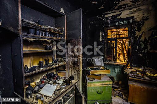 istock Burnt house interior. Burned kitchen, furniture, door, charred walls and ceiling in black soot 915876164